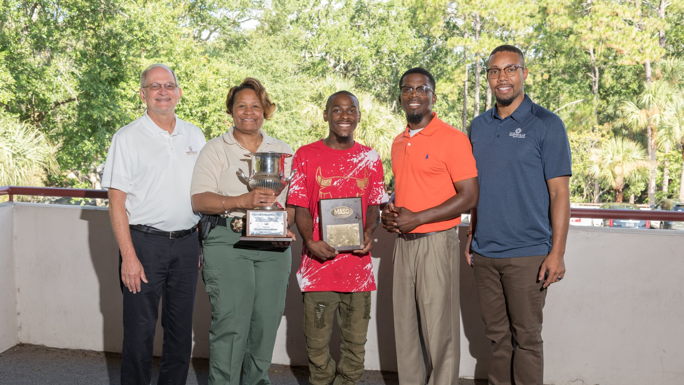 From left to right, Mayor Pro Tem Johnny Andrews, Officer Gloria Mack, Andres Dixon, Pastor Christopher Morgan, and Councilperson Tre Gammage with the MASC award.